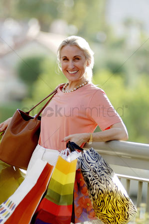 Spending money : Woman carrying paper bags