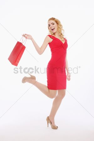 Shopping background : Woman carrying shopping bag