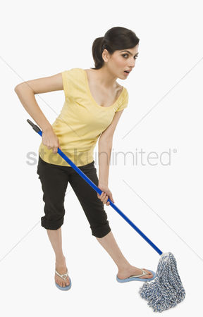Housewife : Woman cleaning floor with a mop