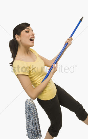 Housewife : Woman dancing with a mop