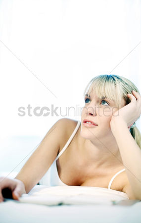 Satisfying : Woman daydreaming on the bed
