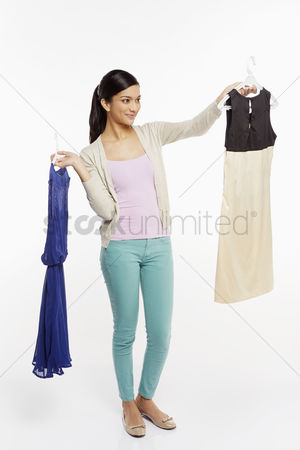 Selection : Woman deciding between two dresses
