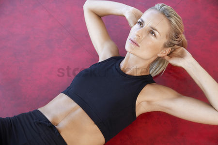 Fitness : Woman doing sit-ups close up high angle view