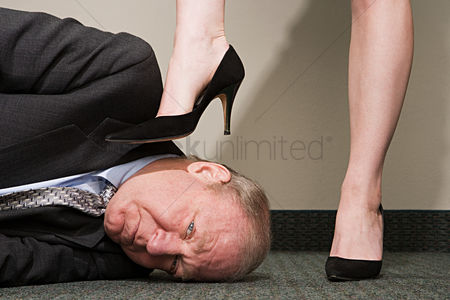 Interior : Woman dominating businessman