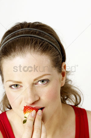 Satisfying : Woman eating strawberries