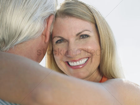 Smile : Woman embracing man portrait close up