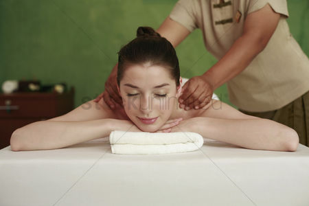 Lying forward : Woman enjoying a back massage