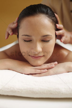 Lying forward : Woman enjoying a head massage