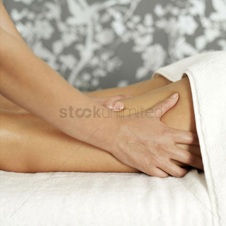 Relaxing : Woman enjoying a leg massage