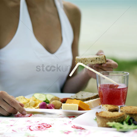 Appetite : Woman enjoying her meal by the beach side
