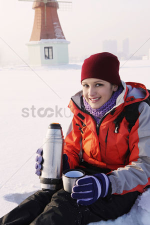 Cold temperature : Woman enjoying hot drink on winter day
