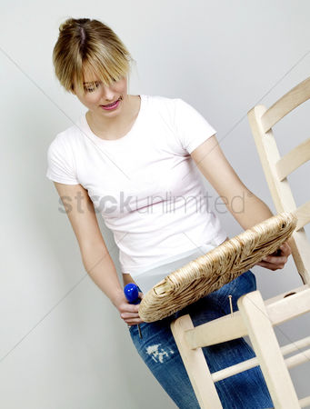 Fixing : Woman fixing a broken chair