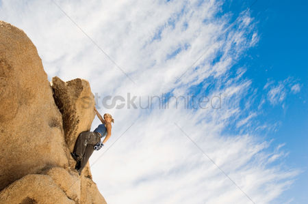 Rope : Woman free climbing on rocks