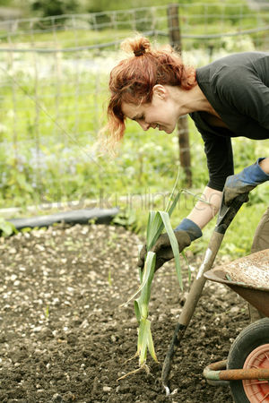 Strong : Woman gardening in the garden