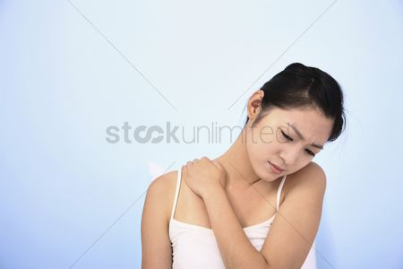 Frowning : Woman having backache