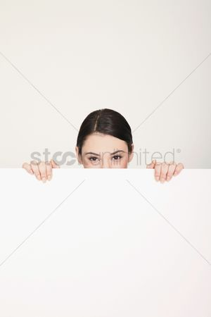 Cardboard cutout : Woman hiding behind blank placard