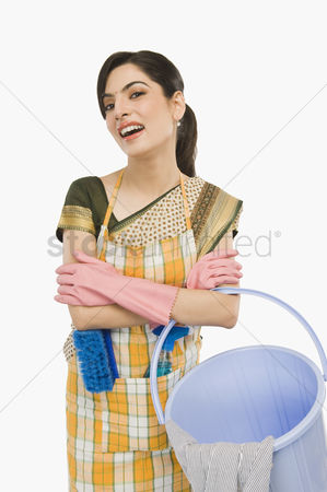 Housewife : Woman holding a bucket