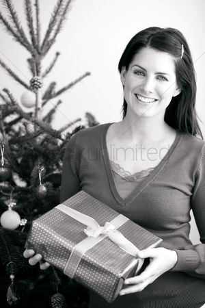 Adulthood : Woman holding a christmas gift