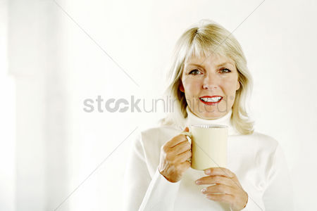Satisfaction : Woman holding a cup