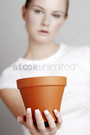 Composed : Woman holding a flower pot