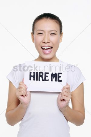 Unemployment : Woman holding a  hire me  sign