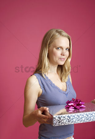 Birthday present : Woman holding a present