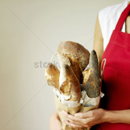 Selection : Woman holding a selection of fresh italian rustic bread