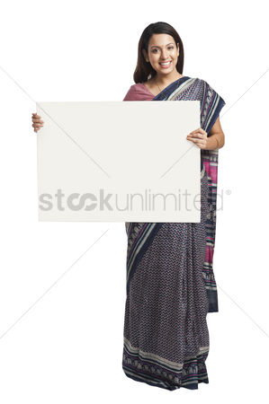Housewife : Woman holding at a whiteboard and smiling