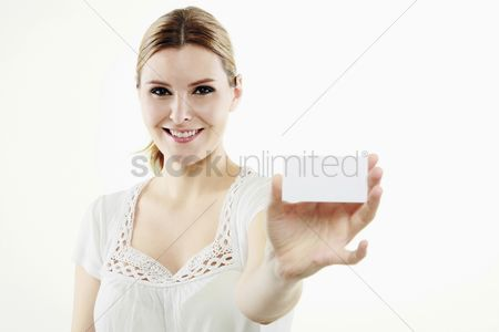 China : Woman holding business card