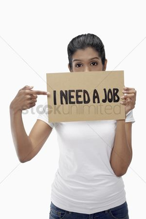Unemployment : Woman holding  i need a job  sign