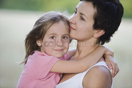 Posed : Woman holding little girl