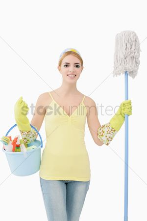 Housewife : Woman holding mop and a pail of cleaning products