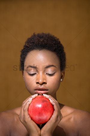Alert : Woman holding pomegranate