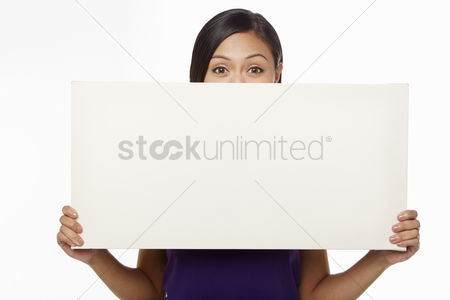 Blank : Woman holding up a blank placard