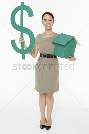 Dollar sign : Woman holding up a dollar sign and a house