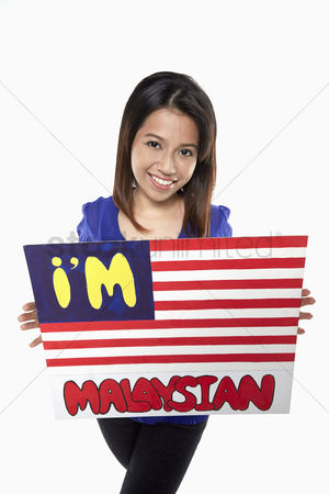 Nationality : Woman holding up a im malaysian