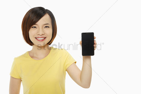 China : Woman holding up a mobile phone