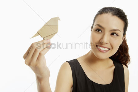 Animal head : Woman holding up a paper bird