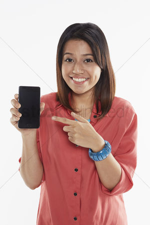 Blank : Woman holding up mobile phone