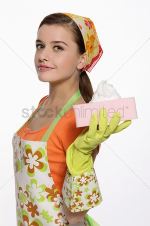 Apron : Woman in apron holding cleaning sponge