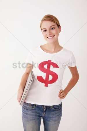 Dollar sign : Woman in dollar sign t-shirt holding laptop