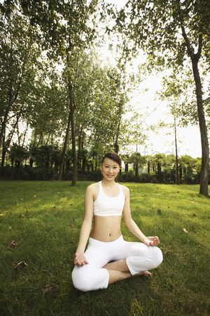 Practising yoga : Woman in lotus position  smiling