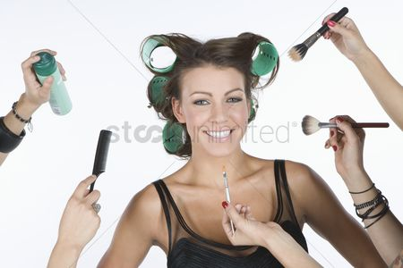 Hand : Woman in rollers  with cosmetics products on hand