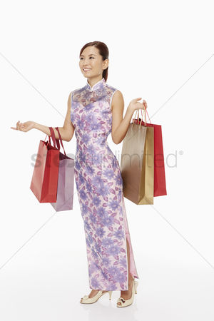 Lunar new year : Woman in traditional clothing carrying shopping bags