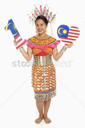 Bidayuh ethnicity : Woman in traditional clothing holding up a number one shape and a heart shape