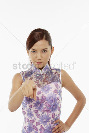 Lunar new year : Woman in traditional clothing pointing at the camera
