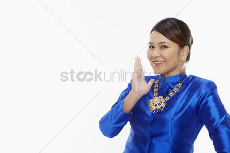 Accessories : Woman in traditional clothing showing hand gesture