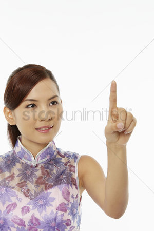 Lunar new year : Woman in traditional clothing showing hand gesture