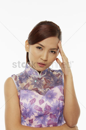 Lunar new year : Woman in traditional clothing touching her forehead