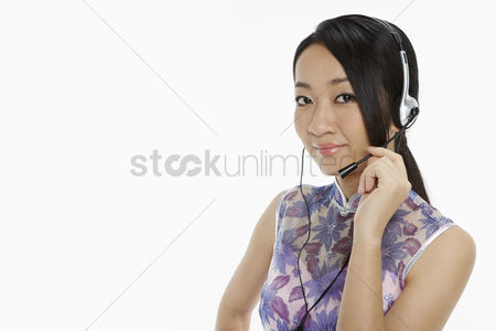 Lunar new year : Woman in traditional clothing with a headset